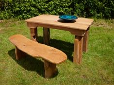 Bespoke dining table and bench handmade by Taran Eco Designs from reclaimed oak.