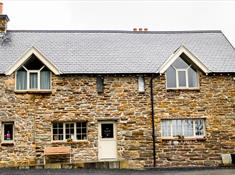 An image of Coes Faen's exterior stone building